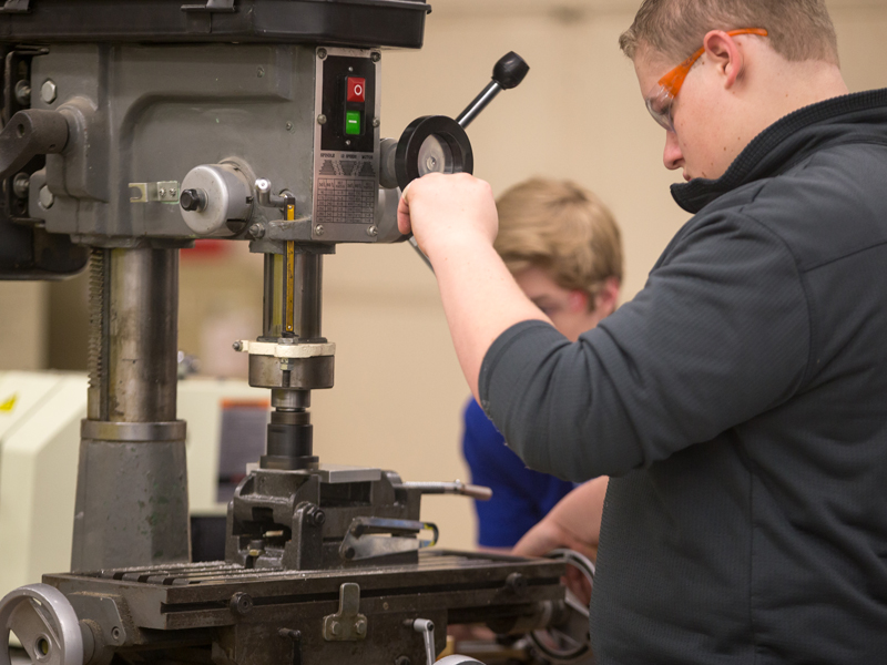 Southview student using drill press